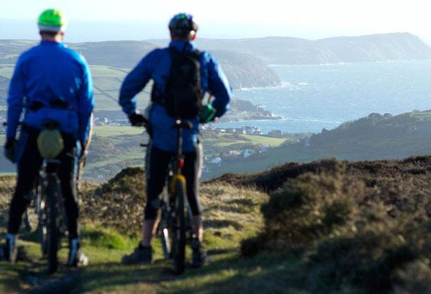 Challenge: mountain bikers admire the view towards Port Erin on the Isle of Man