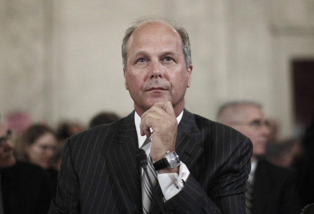 Tim Probert, Halliburton's president of global business, appears before the Senate