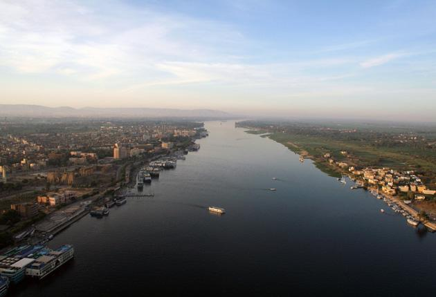 The White Nile rises in East Africa in Lake Victoria and drains through Uganda into Sudan where it meets in Khartoum, with the Blue Nile flowing from Ethiopia's Lake Tana. More than 55.5 billion cubic metres of water pour from the Aswan dam into Egypt ann