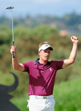 Luke Donald shows his elation after defeating Rhys Davies in the Madrid Masters yesterday, his first victory in four years