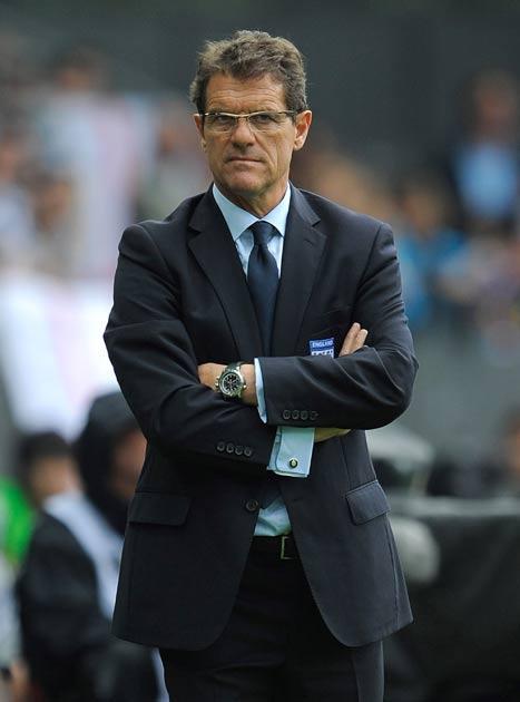 Capello walks the touchline against Japan
