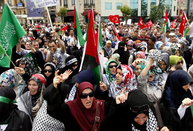 Protesters in Istanbul, Turkey, demonstrate against the Israeli attack on a Turkish ship taking aid to Gaza
