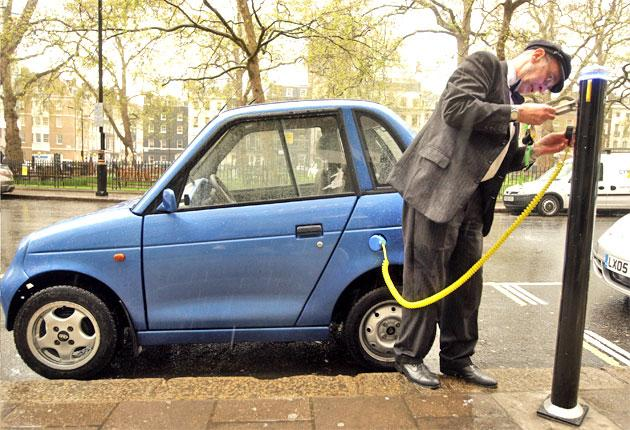 How motorists, such as this G-Wiz driver, can use roadside charge points
