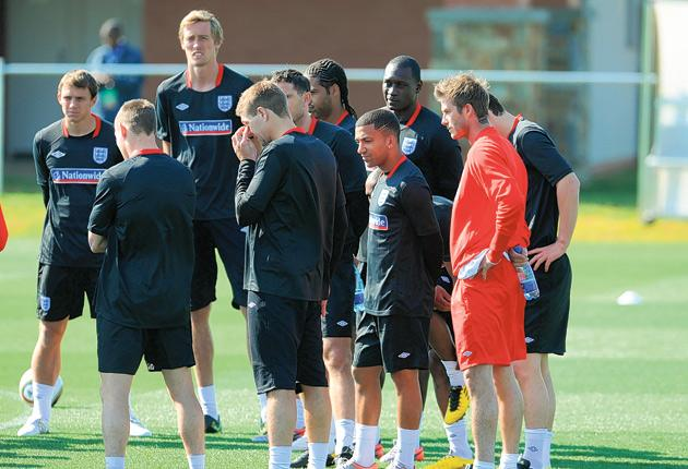 England's players stand glumly in their first training session at Royal Bafokeng yesterday during which captain Rio Ferdinand was injured