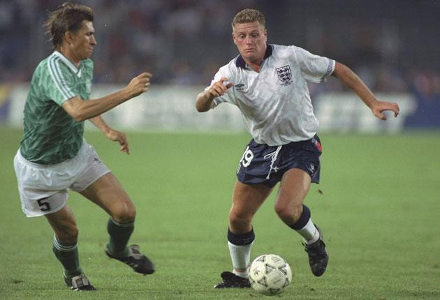 Paul Gascoigne (right) surges past German defender Klaus Augenthaler during the World Cup semi-final at the Stadio delle Alpi in Turin in 1990.