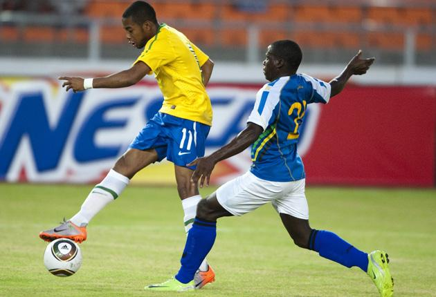 Robinho scores the first of his two goals for Brazil against Tanzania in Dar Es Salaam yesterday