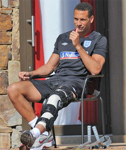 Rio Ferdinand gives his team-mates a thumbs-up as they train yesterday