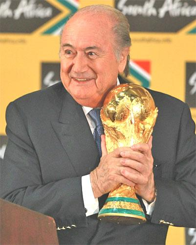 Fifa President Sepp Blatter holds the World Cup trophy. His organisation will today announce yearly profits of $2.5bn