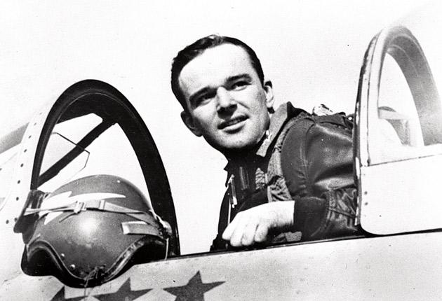 Colonel Bud Mahurinin the cockpit of an F-86 Sabre jet at an airbase in Korea in March 1952, shortly before his capture