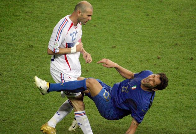 Zinedine Zidane headbutts Italy's Marco Materazzi during the World Cup final in the Olympiastadion