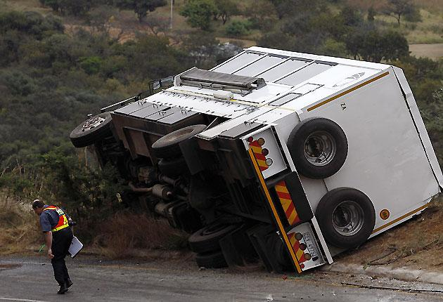 This bus carrying British tourists crashed on a notorious mountain road in northeast South Africa, killing two 19-year-old women