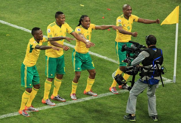 Siphiwe Tshabalala celebrates the opening goal of the World Cup with his team-mates