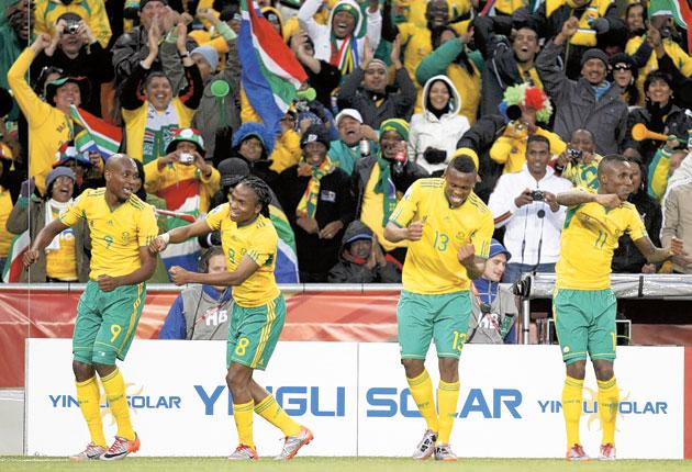 Siphiwe Tshabalala (second left) leads the celebrations after opening the scoring for South Africa yesterday