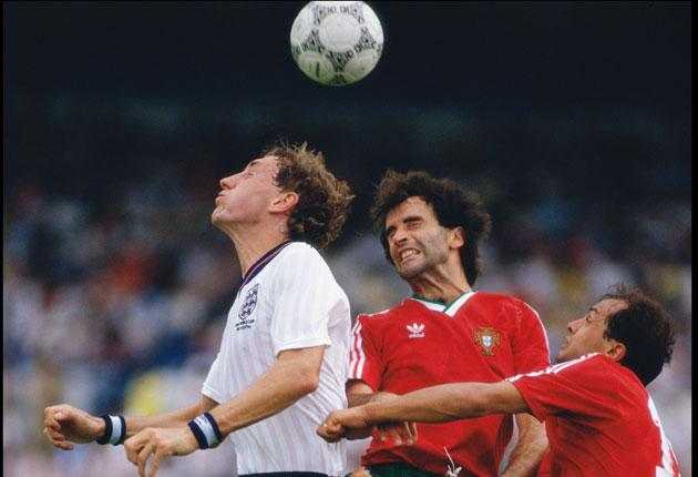 Terry Butcher (left) tangles with the Portuguese during England's opening defeat in 1986
