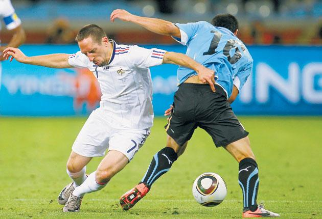 Franck Ribéry tangles with Uruguay's Maximiliano Pereira during their sides' 0-0 draw in Cape Town last night