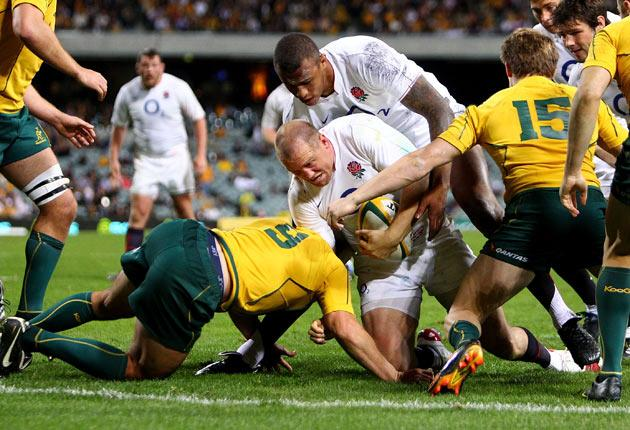 Mike Tindall of England is tackled during the Cook Cup Test match