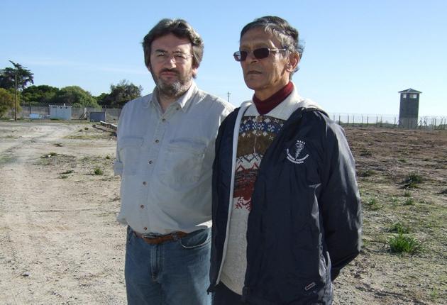 Pitch battle; Fergal Keane, left, meets activist Seddick Issacs on Robben Island for Football's Freedom Fighters