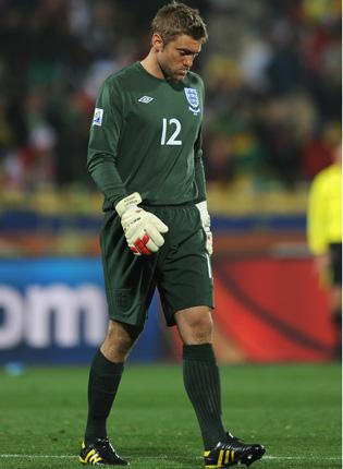 Robert Green contemplates the scale of his blunder on Saturday