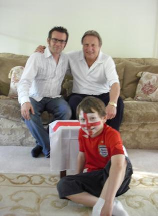 Our competition winner Richard Romaniak (left) joins Neil Warnock and his son Will at their home