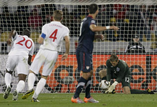 Robert Green appears to have Clint Dempsey's shot covered before fumbling the ball into his net