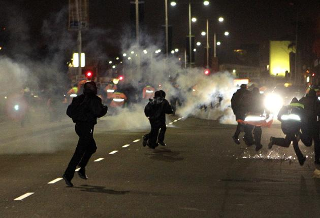 World Cup stewards scatter as Durban police open fire with tear gas canisters