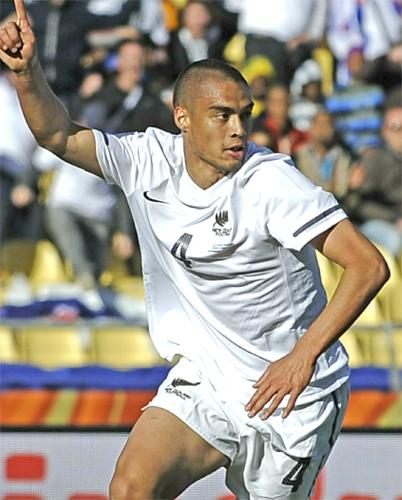 Winston Reid celebrates after scoring his injury-time equaliser for New Zealand