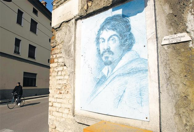A painting of Caravaggio on a wall near the house where he was born in the northern Italian town of the same name