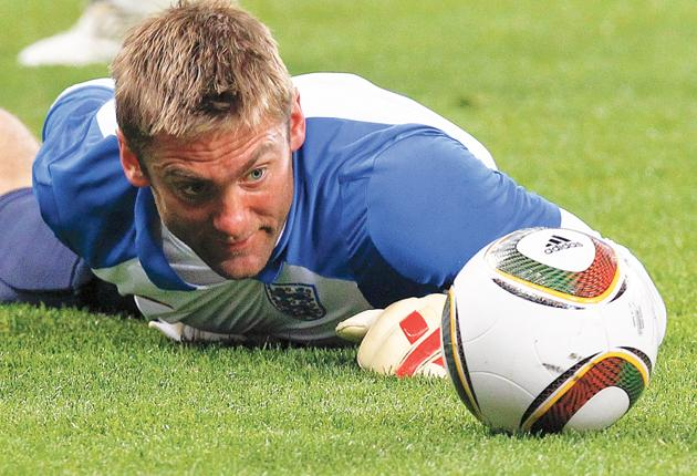 Robert Green eyeballs his adversary, the Jabulani, during England's training session in Cape Town yesterday