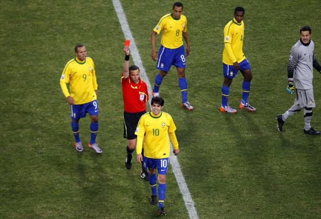 Kaka (10) can only smile as he is sent off during Brazil's victory over Ivory Coast last night