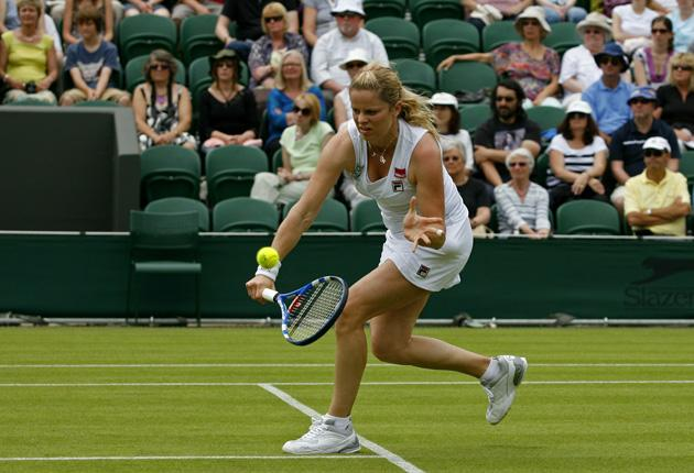 Kim Clijsters plays a backhand during her 6-0, 6-3 victory at Wimbledon yesterday