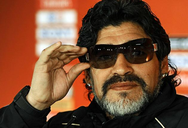 During a press conference in Pretoria yesterday Diego Maradona shows off a new pair of sunglasses given to him as a fathers day gift