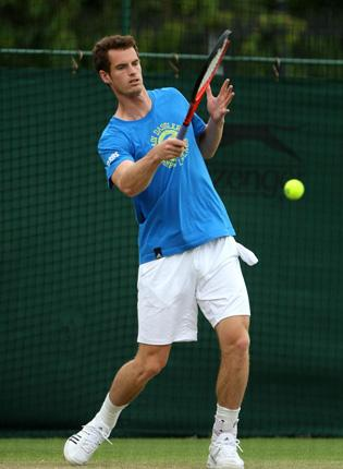 Andy Murray, who admits he has never seen today's opponent play, practises yesterday at Wimbledon