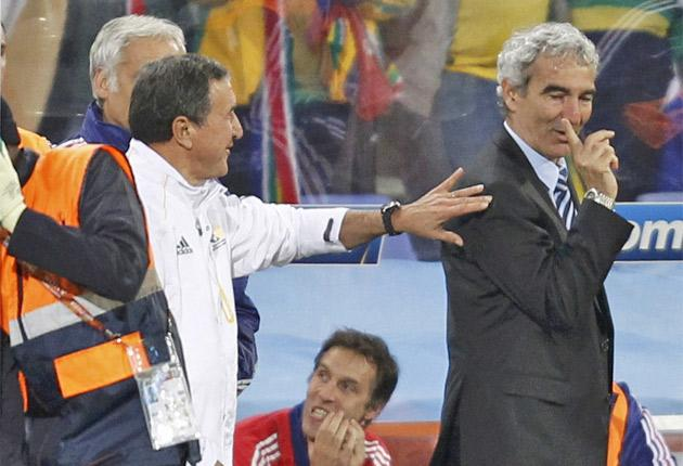 Raymond Domenech vents his anger at the South Africa coach Carlos Alberto Parreira at the final whistle yesterday