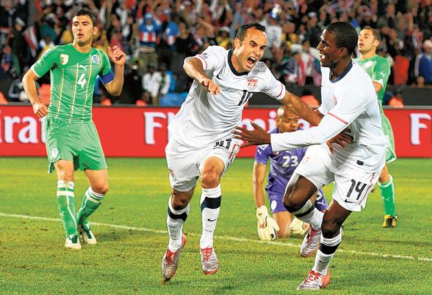 Landon Donovan wheels away in delight after scoring the winner in front of former US president Bill Clinton