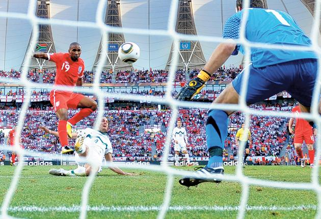 Jermain Defoe scores against Slovenia to guarantee England's progression into the last 16