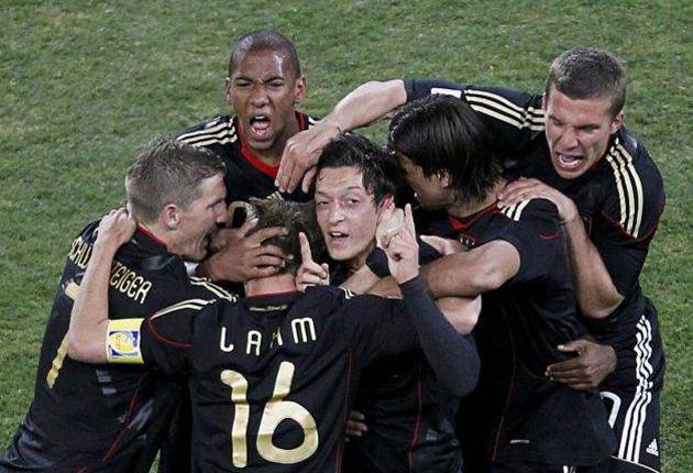 The German team celebrate Mesut Ozil's winner