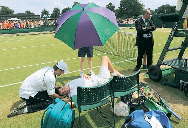 John Isner needed treatment from the physio during his match against Holland's Thiemo De Bakker yesterday at Wimbledon