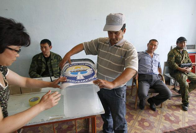 Local election officials in Osh prepare ballot boxes for today's constitutional vote in Kyrgyzstan