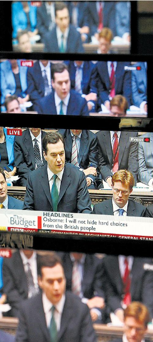 George Osborne's first budget, as screened on sets in an electrical store