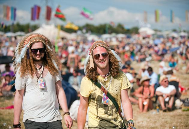 Revellers wear Native American head-dresses as the temperatures remain high at the Glastonbury