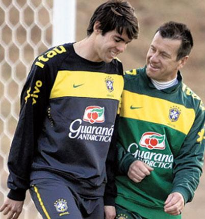 The Brazil head coach Dunga talks to Kaka during a training session in Johannesburg