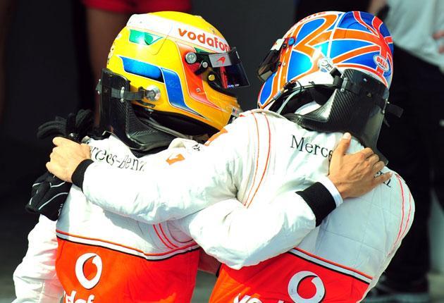 Championship leader Lewis Hamilton (left) and Jenson Button, the world champion