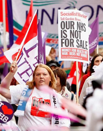 Workers and supporters of the NHS at a rally in London