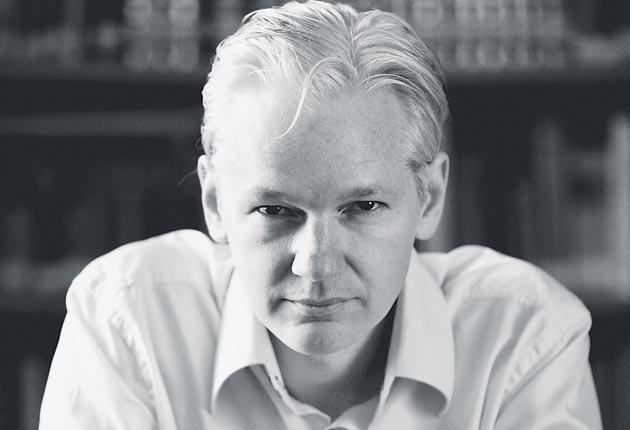 Julian Assange: appearing in Britain, despite the arrest of one of his site's alleged sources