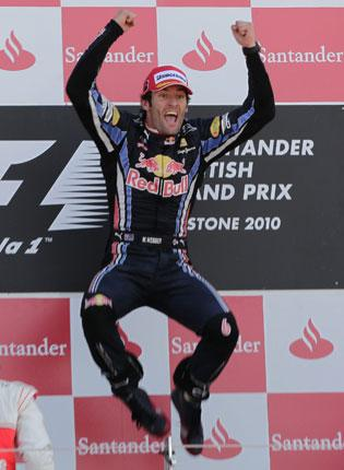 Mark Webber jumps for joy following his British Grand Prix victory