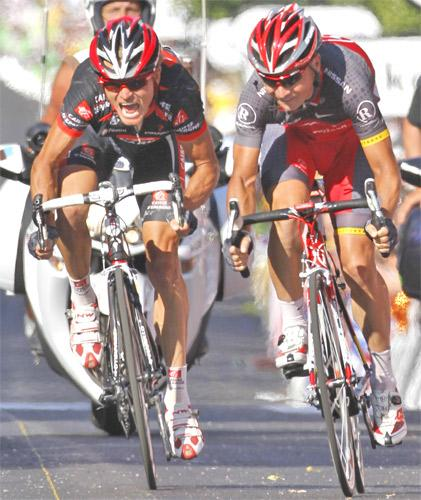Sergio Paulinho (right) beats an anguished Vasil Kiryienka by less than half a wheel's length to claim victory in yesterday's stage of the Tour de France