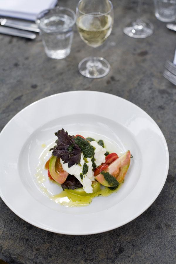 A salad of mozzarella, tomato and basil oil