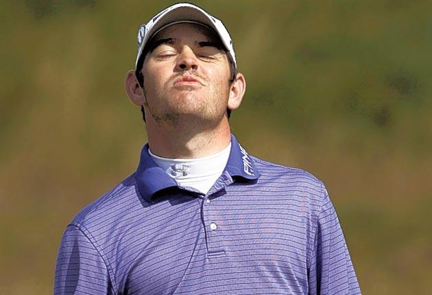 Louis Oosthuizen tries to look worried after missing a putt during yesterday's superb round
