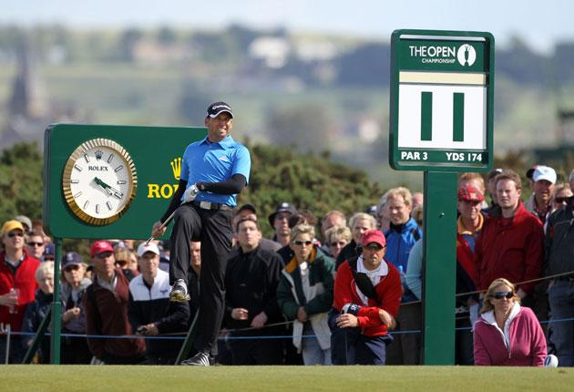 A high-kicking Sergio Garcia reacts to his tee shot at the 11th hole yesterday. After curing his putting problems, the Spaniard is in contention