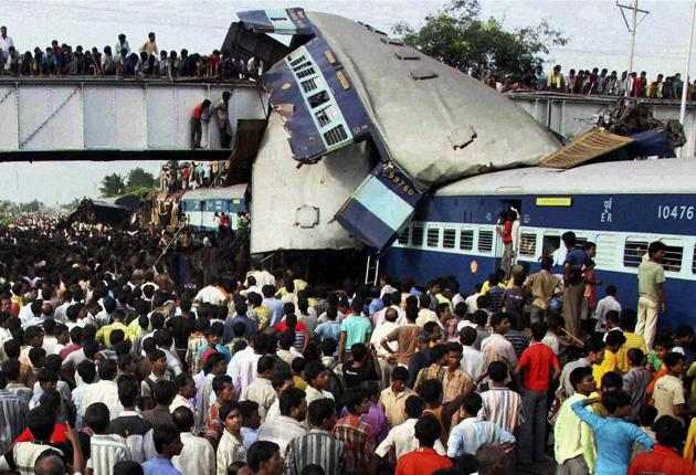 Rescue workers search the wreckage of two trains at Sainthia station, 125 miles north of Kolkata